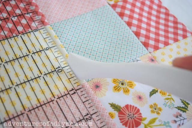 nine patch quilt block, a ruler and a point turner