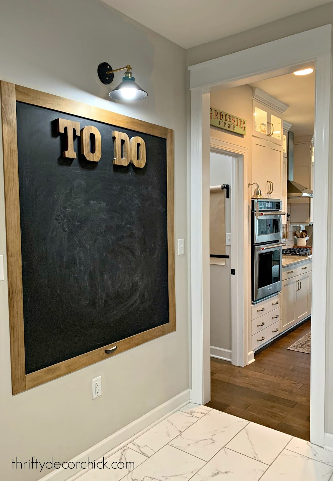 Large DIY chalkboard in mud room