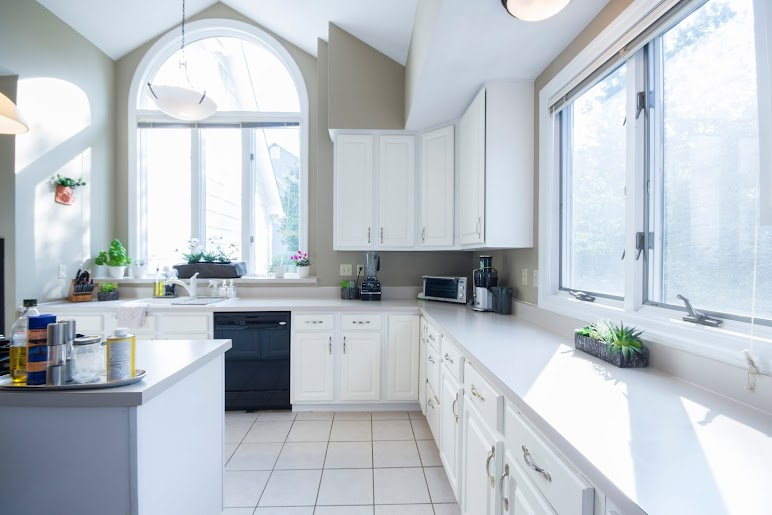 Empty Kitchen With White Wooden Cabinet