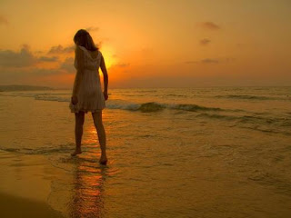 Sad-girl-upset-over-love-breakup-walking-alone-in-beach-sunset-image.JPG