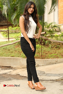 Actress Chandini Chowdary Pictures in Black Denim Jeans at Kundanapu Bomma Telugu Movie Press Meet  0150.JPG