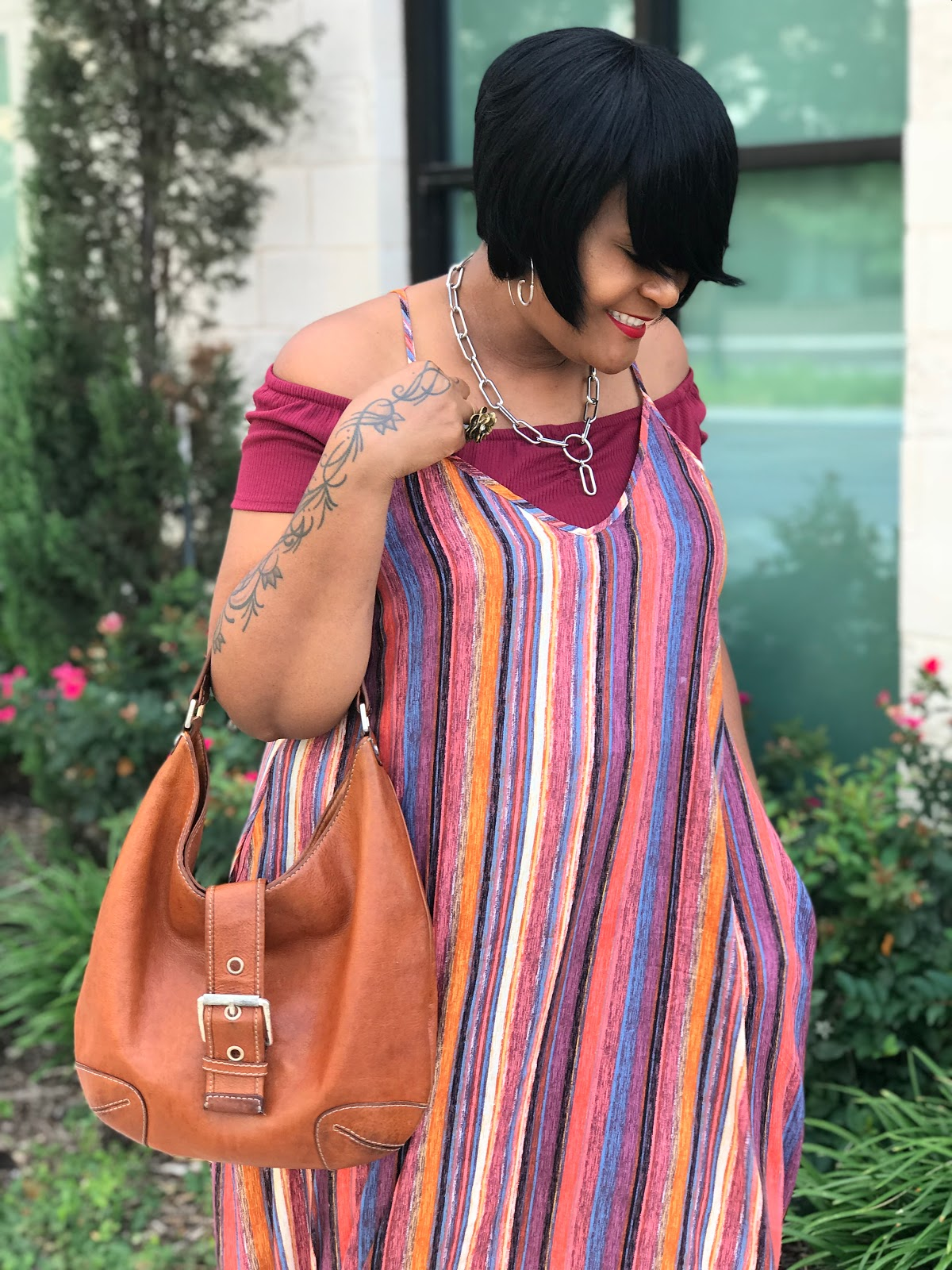Image: Woman sharing how she mixes old clothes with new clothing and accessories