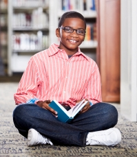 Most rewarding NAMC montessori student boy reading