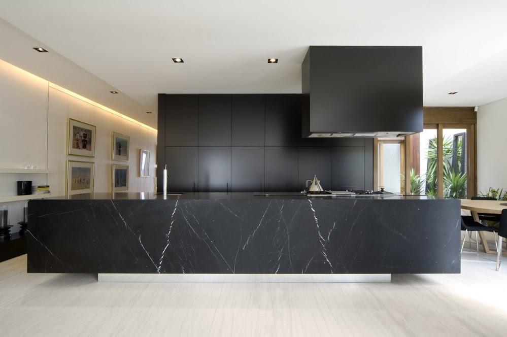 block-black-kitchen-large-marble-benchtop-wooden-flooring