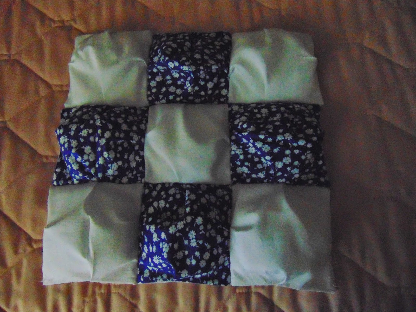 Blue and white alternating puffs or biscuits assembled for pillow or doll quilt