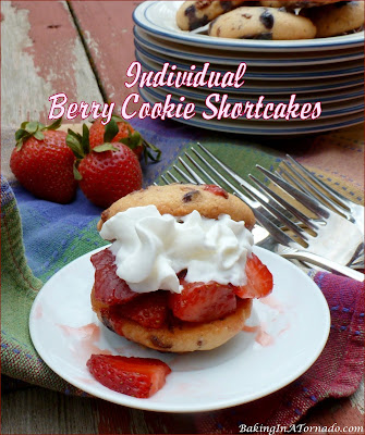 Individual Berry Cookie Shortcakes. The cookies are made with muffin mix and toffee chips, serve with macerated strawberries and whipped cream for a light summer treat. | Recipe developed by www.BakingInATornado.com | #recipe #dessert