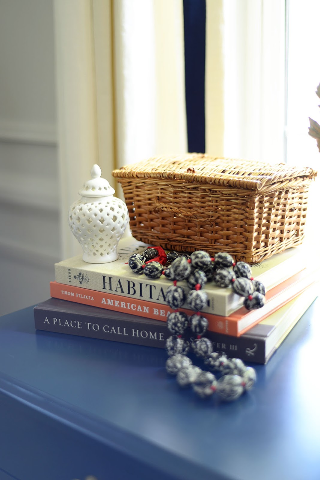 objects on books, habitat book lauren liess, mini ginger jar, woven box, fall decorating ideas, fall living room
