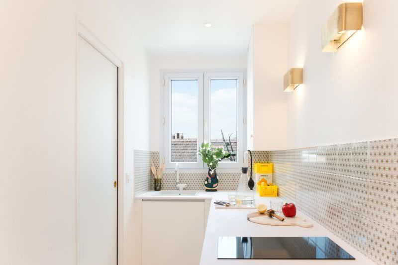 Ample lighting makes the kitchen more spacious.