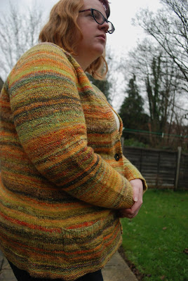 Striped combospun sweater in oranges, browns, and yellows, merino and wool and silk and alpaca