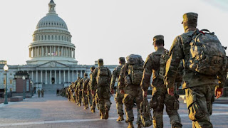 Troops guard US Capitol, one week after riots