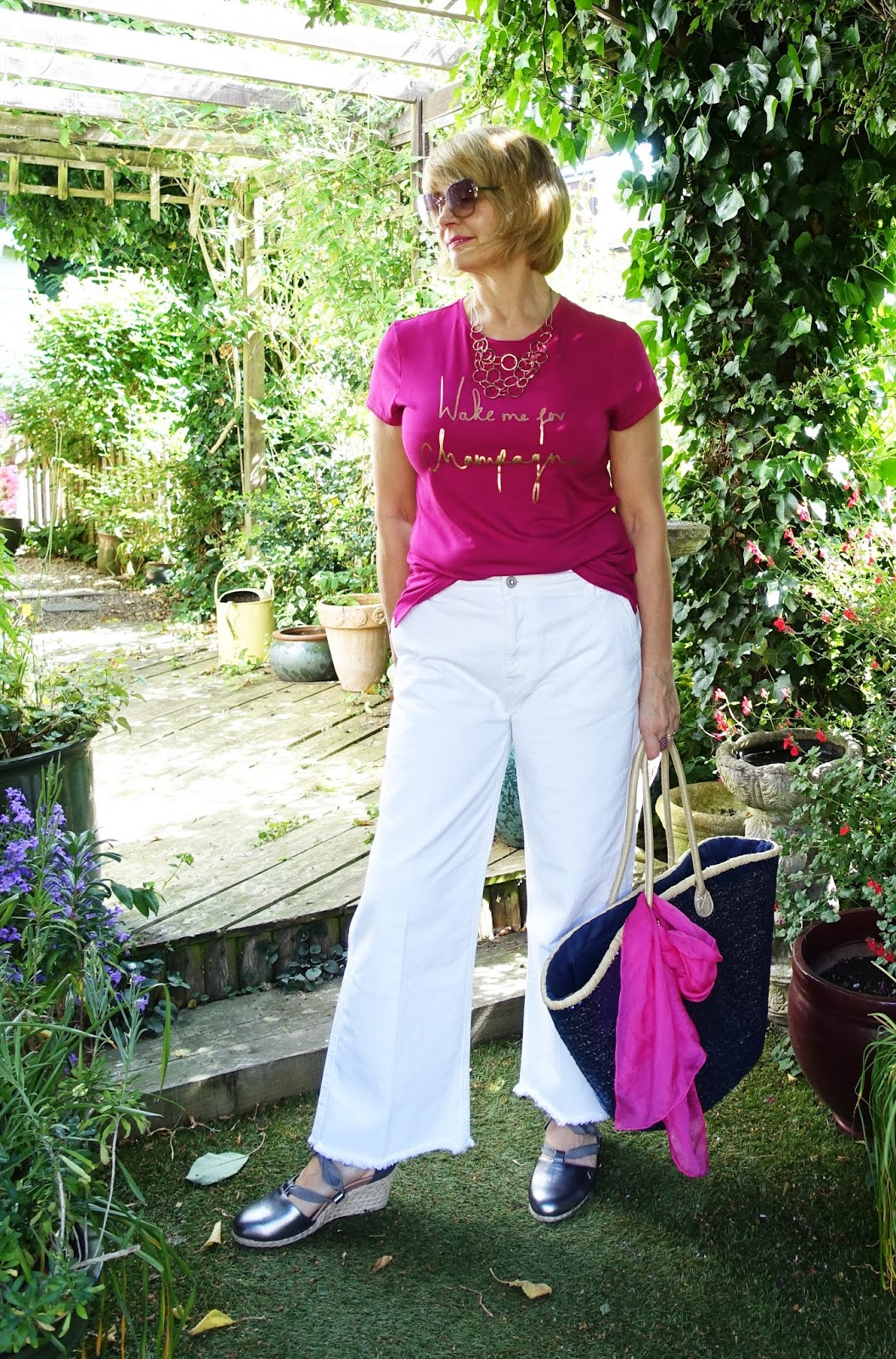 Gail Hanlon from Is This Mutton in pink t-shirt from Ted Baker white Pepe jeans and Vionic Kaitlyn sandals in pewter leather