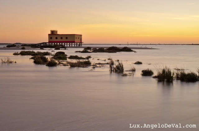 http://fineartamerica.com/featured/lifesavers-building-at-dusk-in-fuzeta-portugal-angelo-deval.html