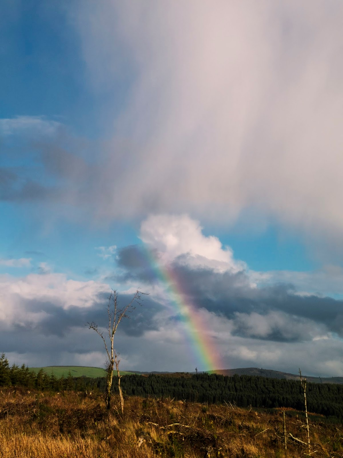 Big clouds and a rainbow in the mountains of North Cork.