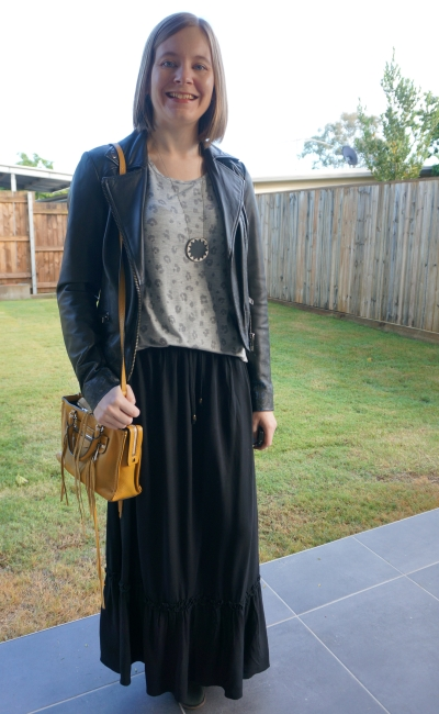 wearing a grey leopard print tee in monochromatic winter maxi skirt and leather jacket outfit yellow bag | away from blue