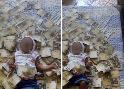 Nigerian Dad Got Slammed After Uploading Photo Of His Baby Covered With N1000 Notes (Photo)