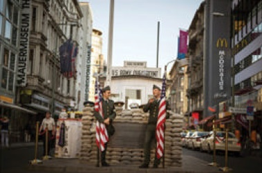 Actors at a replica of the original Checkpoint Charlie