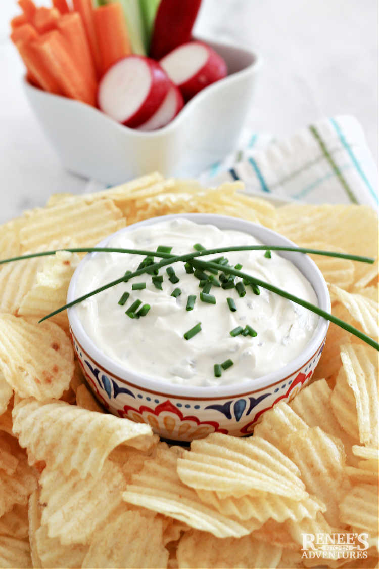 Lawson's Chip Dip in bowl, garnished with chives surrounded by chips