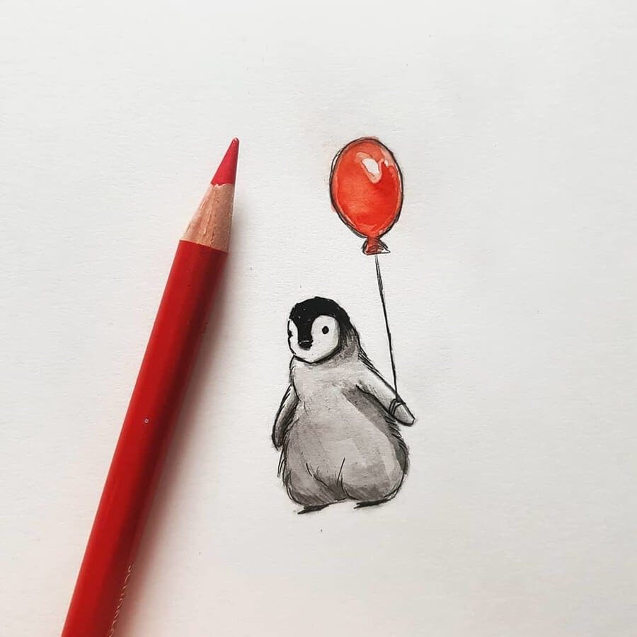 05-Penguin-with-a-red-Balloon-Kleevia-Animal-Art-www-designstack-co