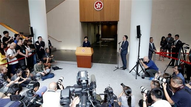 Hong Kong's Chief Executive Carrie Lam promises 'platform for dialogue' after peaceful rally