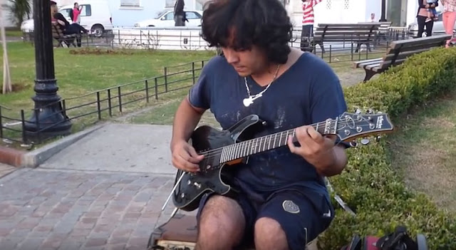 A screen capture from the video of Damien Salazar performing