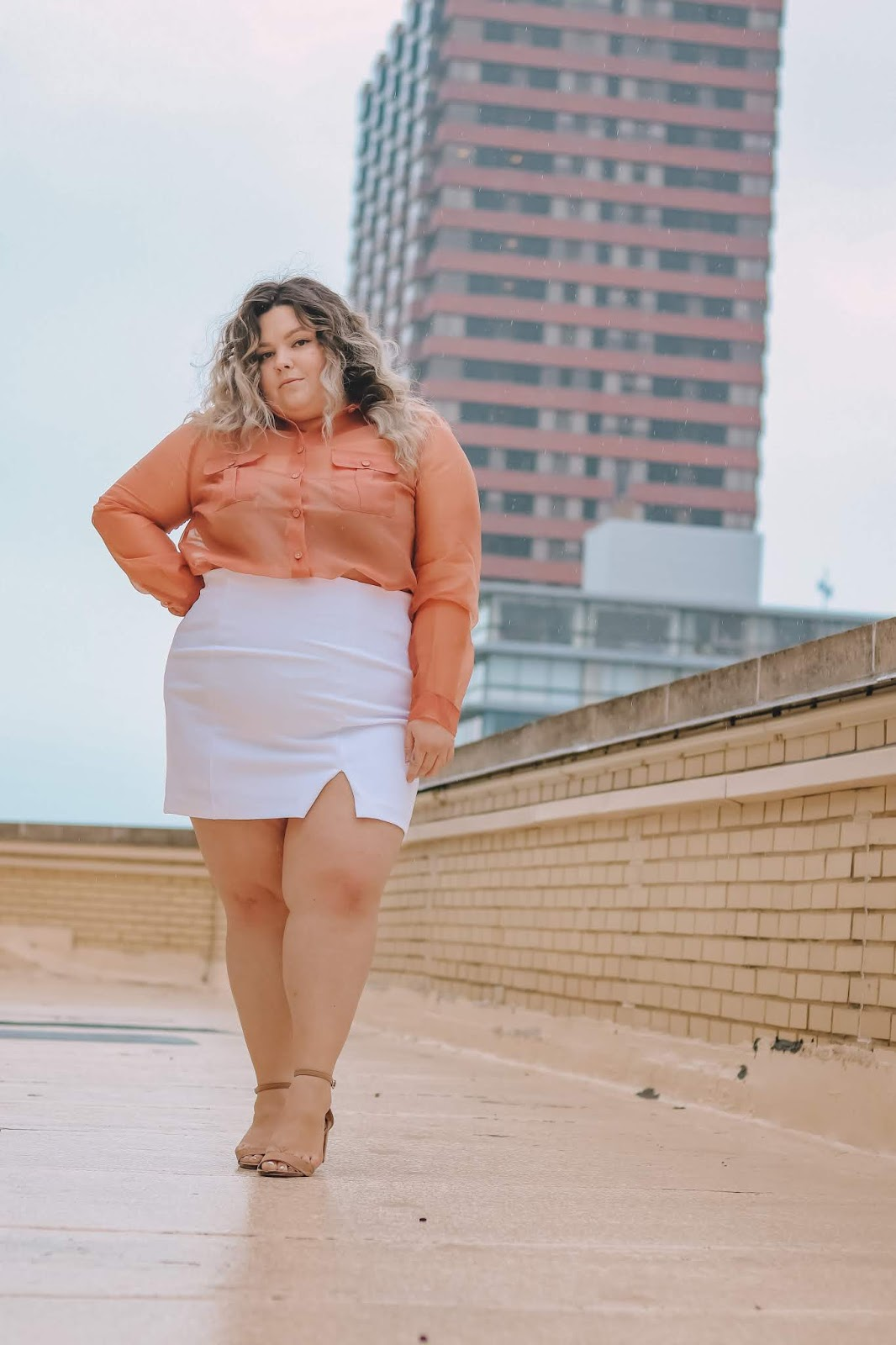 Chicago Plus Size Petite Fashion Blogger, influencer, YouTuber, and model Natalie Craig, of Natalie in the City, reviews Forever21 plus' mini skirts and organza crop tops.