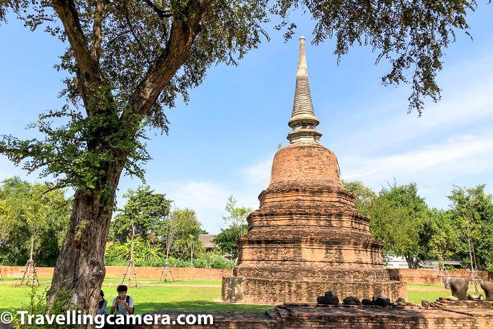 Above photograph shows the scale of even smaller parts of the temple. Please notice the couple sitting around the tree and compare the size of smaller structure in the background.     Wat Ratchaburana in Ayutthaya was built following Khmer design concepts and the design looks very similar to mountain temples of Angkor Wat in Siem Reap, Cambodia. The monastery faces East, the direction of the rising sun.    Related Blogpost - Chatuchak Market, Bangkok - The Largest Market of Thailand