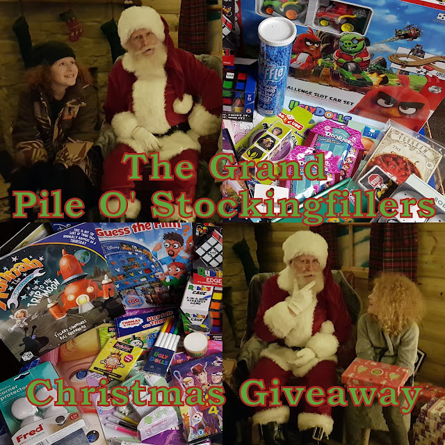 Pile O Stockingfillers Christmas Present Giveaway collage 2 photos of boys with Santa and 2 photos showing games and toys and books etc