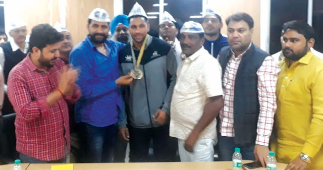 Leader Naveen Jaihind honors Tilpath resident silver medalist Lokesh Sharma