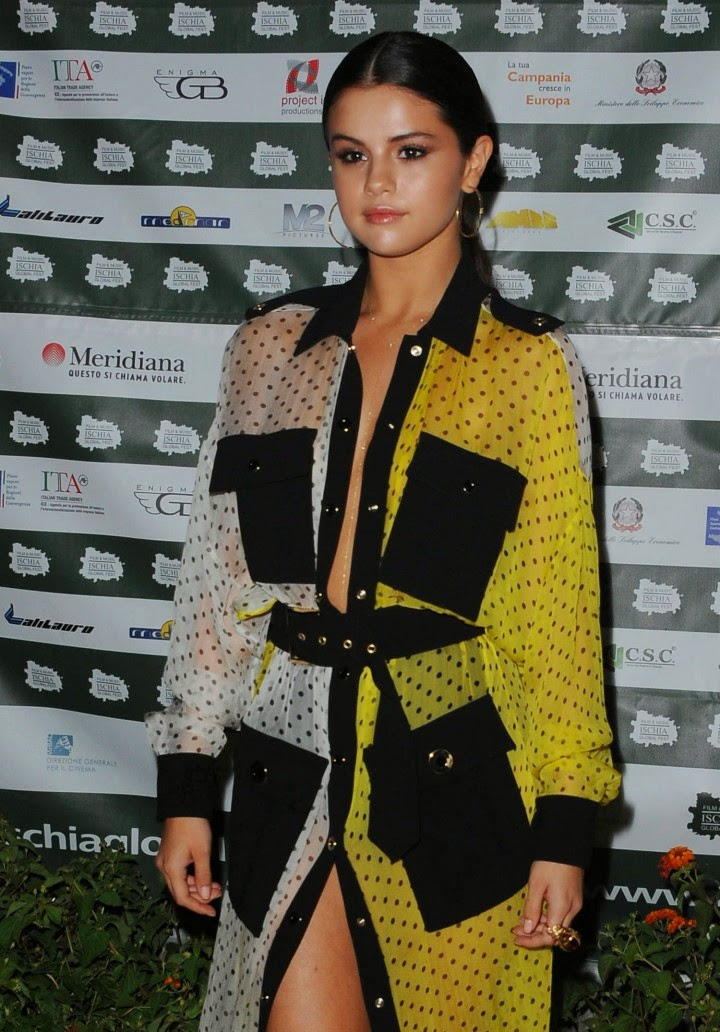 Selena Gomez goes braless in a polka dotted dress at the 2014 Ischia Global Festival in Italy