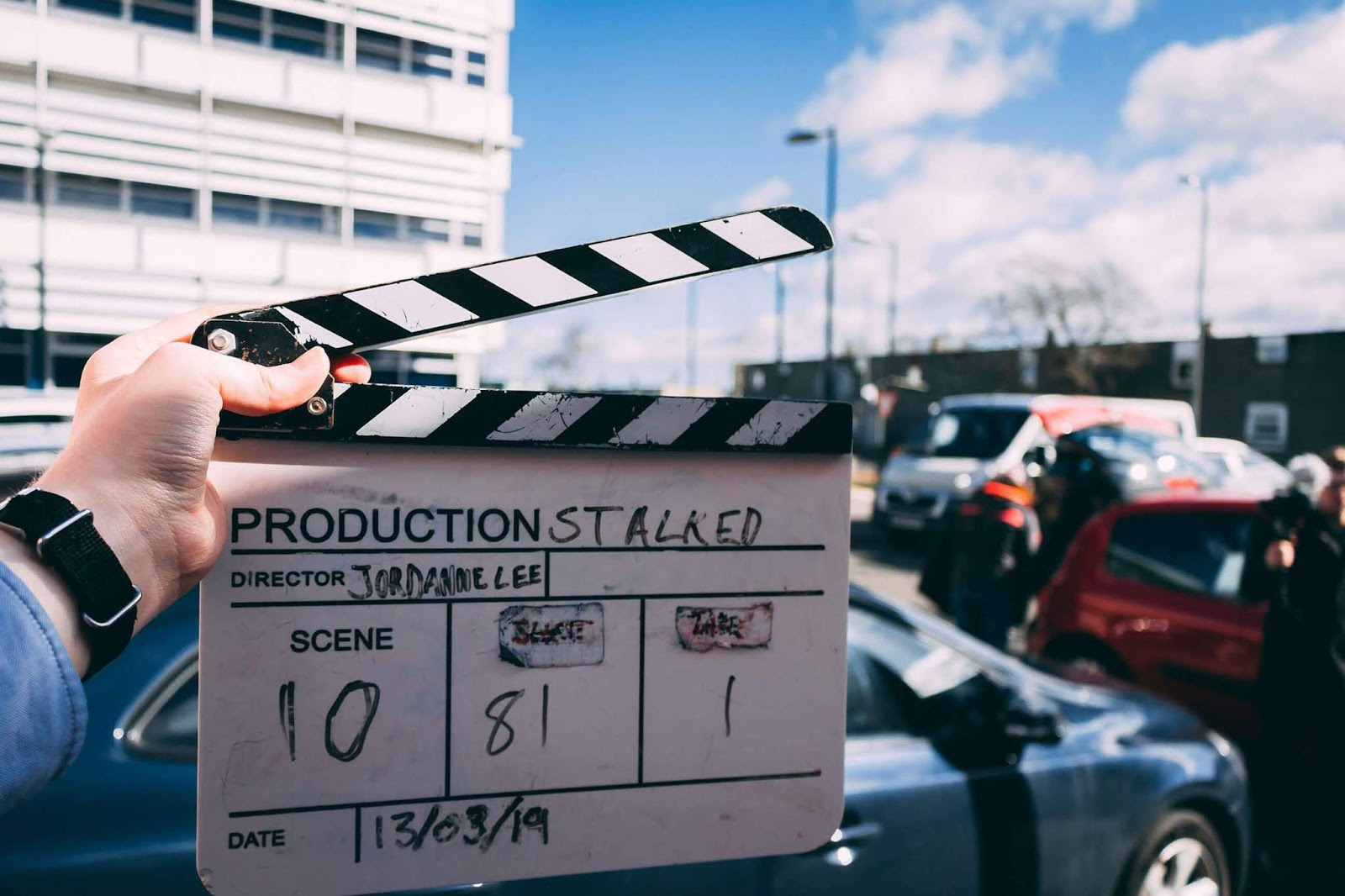 A close up photo of the clapperboard that was used whilst filming my first solo short film by Donald Mcleod. The clapper is black and white with blue sky in the background.
