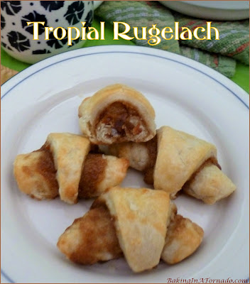 Tropical Rugelach is cream cheese based dough, topped with a sweet filling and rolled up crescent style. Featuring orange, pineapple and ginger this cookie makes you long for summer. | Recipe developed by www.BakingInATornado.com | #recipe #bake