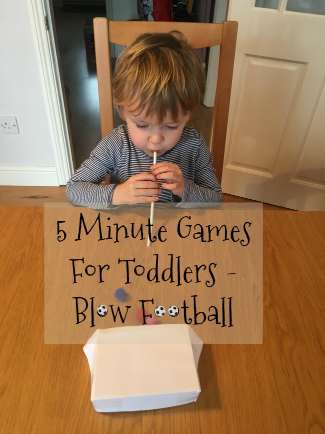 5-minute-games-for-toddlers-blow-football-text-over-image-of-toddler-with-straw-and-pompom-on-table