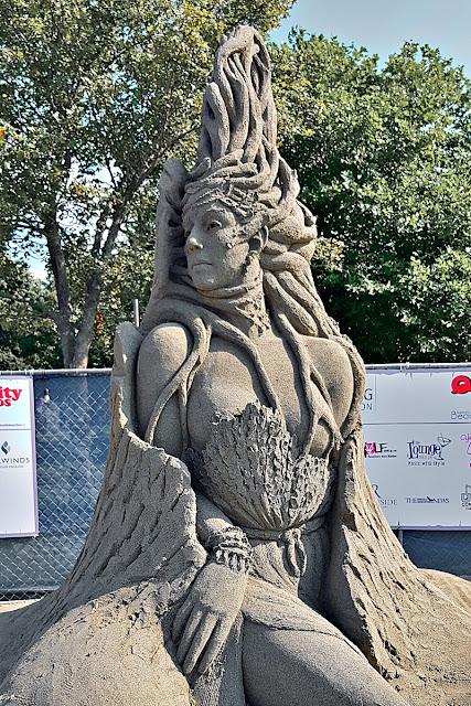 A sand sculpted queen casts a royal look.