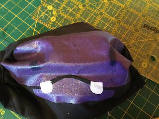 A purple hippo mask