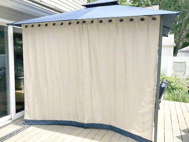Gazebo curtains closed for sun protection