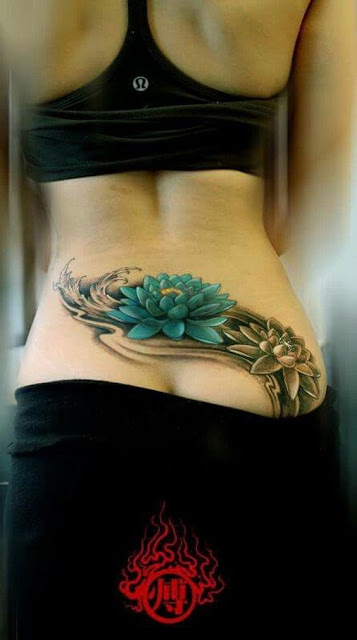 Lower Back Lotus Flower Tattoo For Women