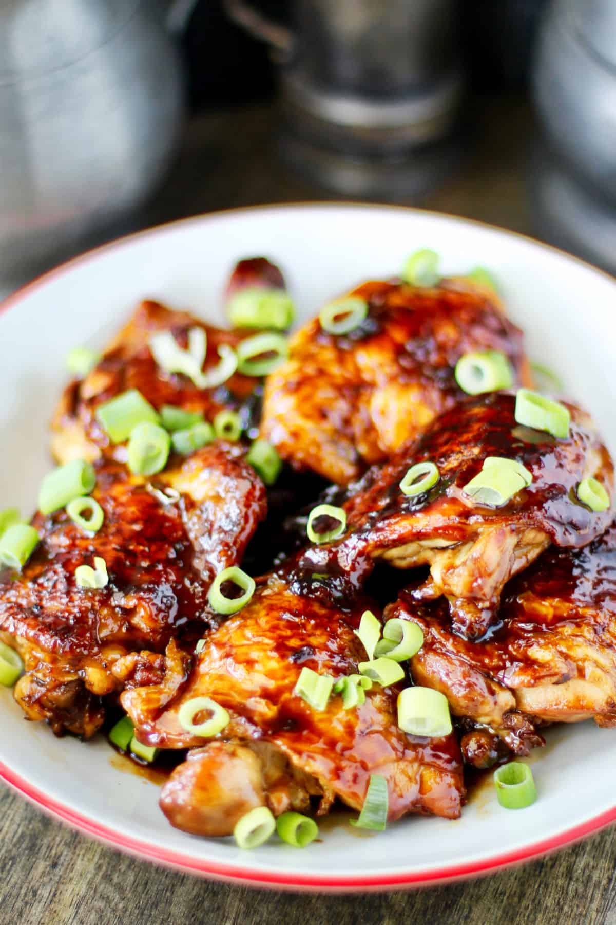 Garlic and Ginger Caramel Chicken Thighs in a bowl.