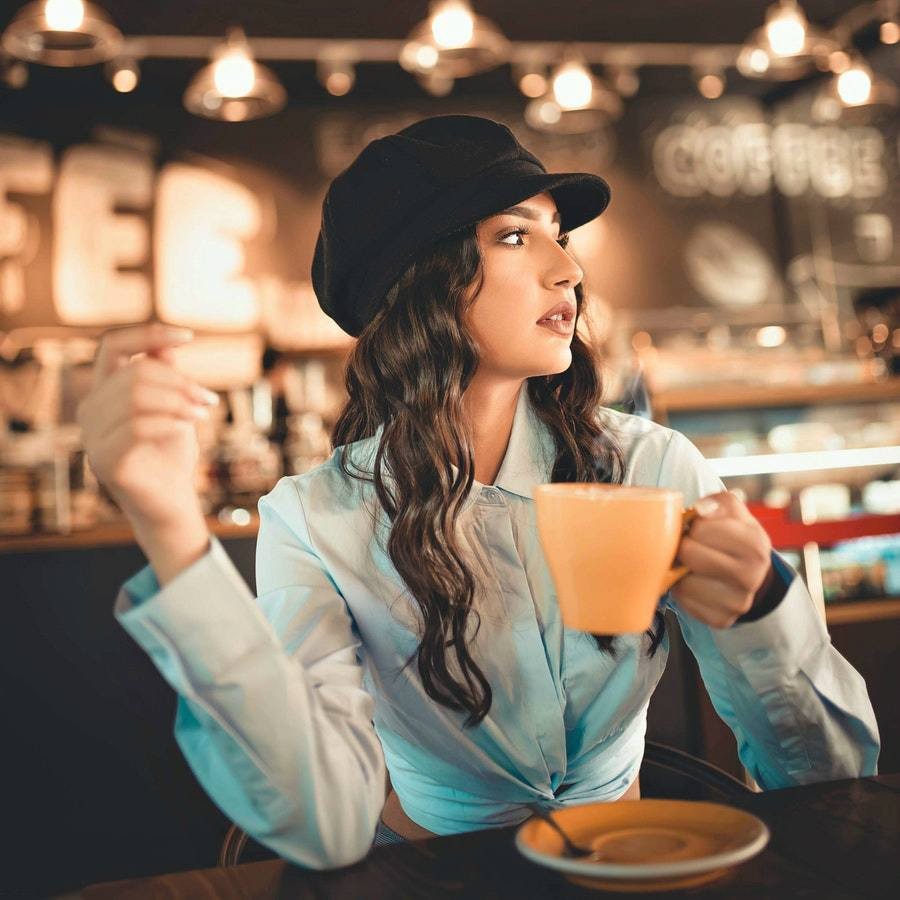 woman-holds-coffee