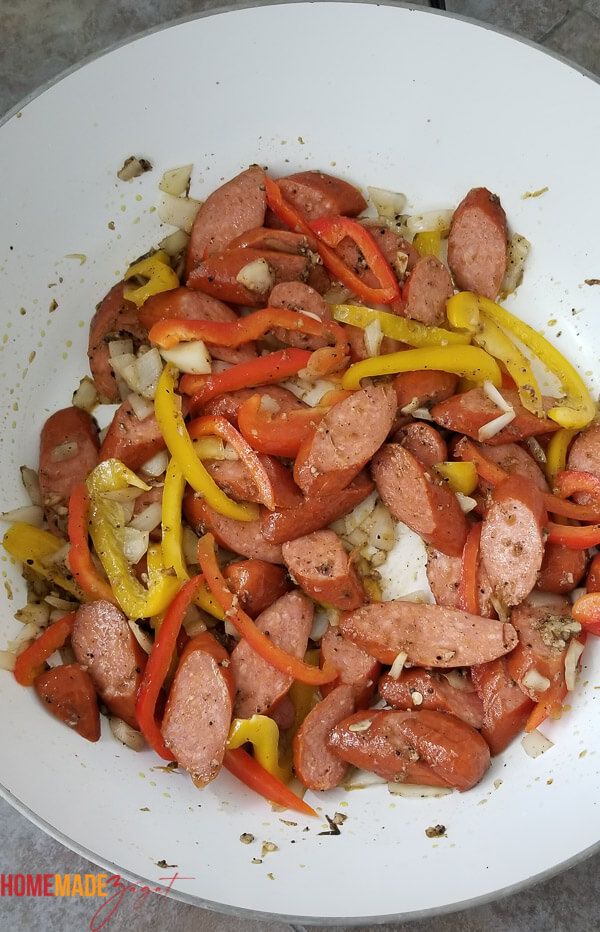 Sausage mixed up with bell peppers, jerk seasoning and onions