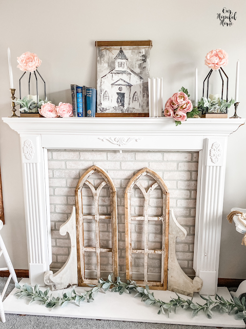 white faux fireplace cathedral arch mantel decor