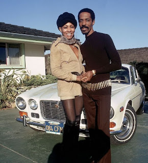 Ike Turner with his ex-wife Tina Turner in front of classic car