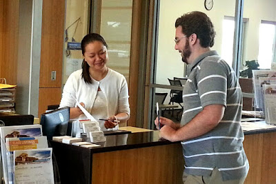 Image of a rio employee at Comm QC working with a student