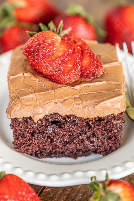 slice of chocolate cake topped with strawberries
