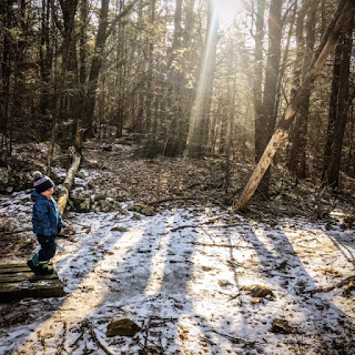 Child walks in Morning light on the Cutts Island Trail in Kittery Maine