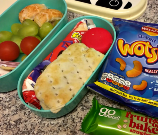 My girls packed lunch including crisps, sandwiches, fruit, tomatoes and some biscuits.