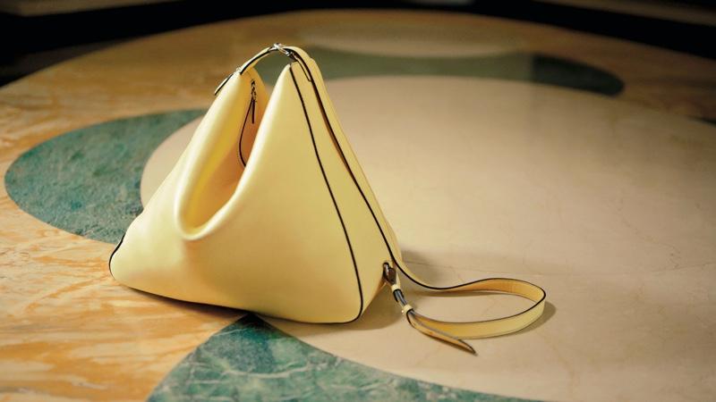 Salvatore Ferragamo Trifolio bag featured in spring 2021 campaign.