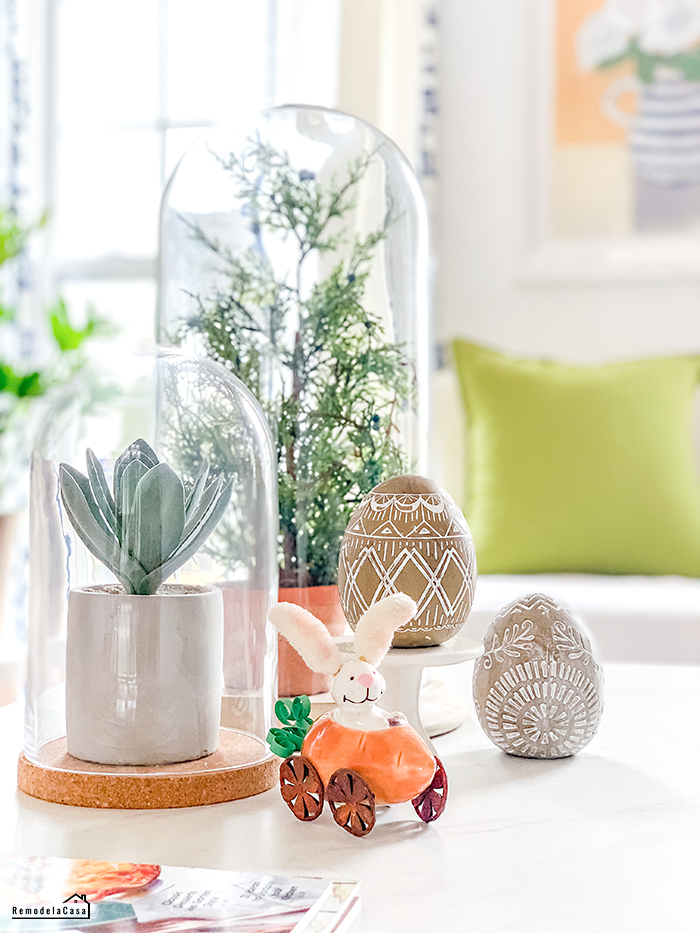 Coffee table decor with Easter eggs and rabbit