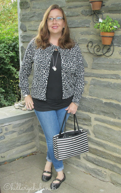 Black and White Leopard Print Cardigan Styled with Skinny Jeans and a Black T