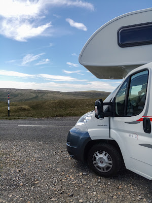 Photo of the cab of the motorhome, set against the breathtaking North Pennine scenery.