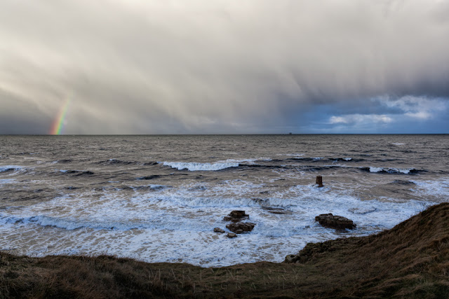 Storm clouds produce a rainbow over the sea at Marsden in South Shields